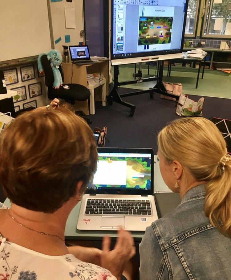Two teachers do collaborative professional development.